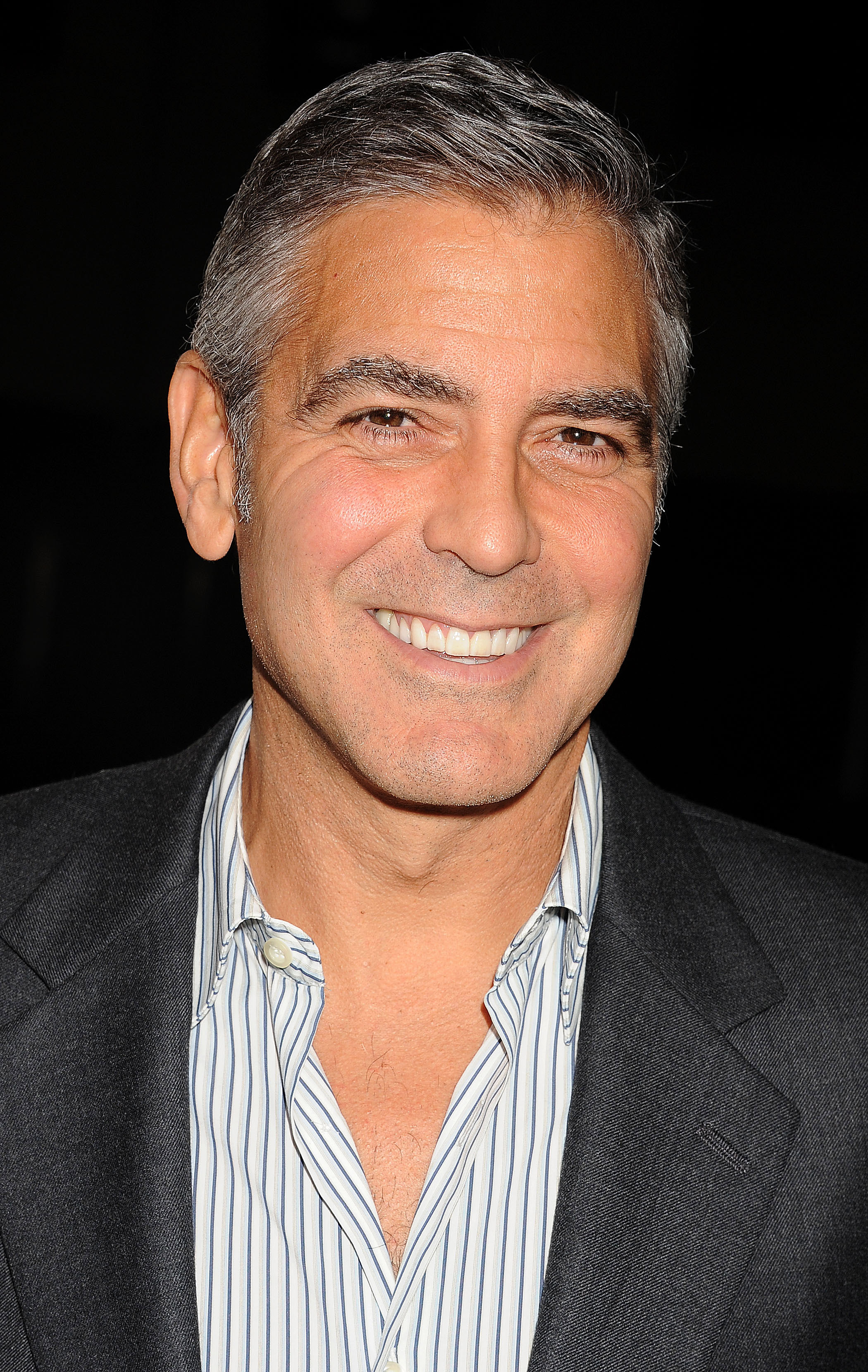 <b>George Clooney</b> gave a winning smile on the red carpet. - George-Clooney-gave-winning-smile-red-carpet
