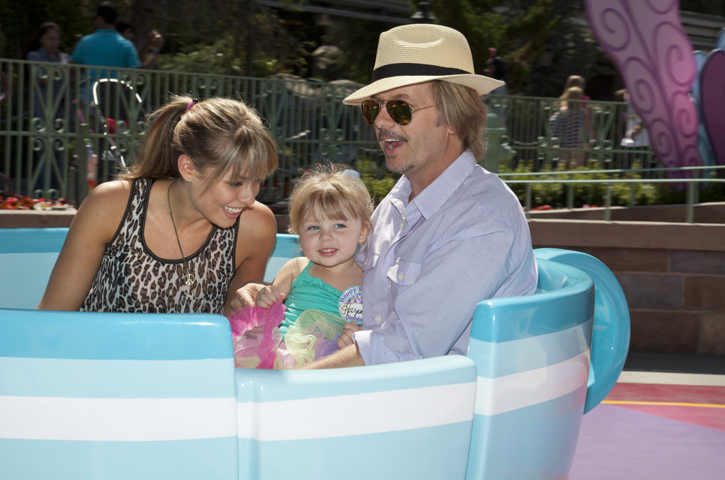 David Spade and Jillian Grace took their daughter for a spin on the teacups in September 2011.