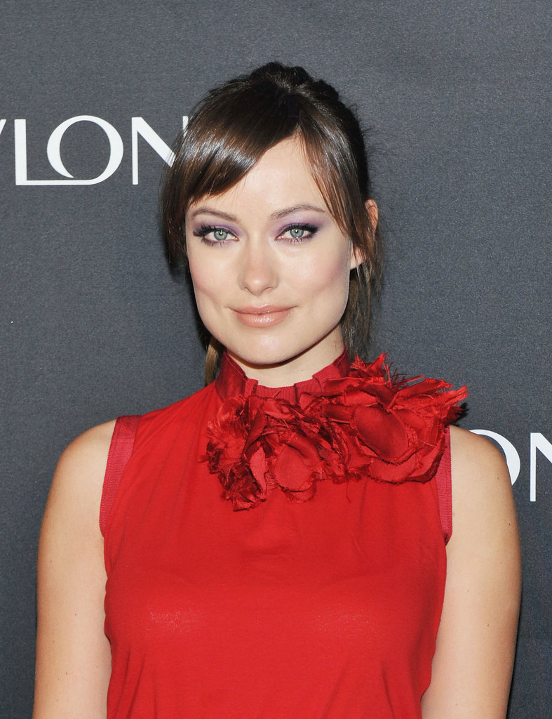 Olivia Wilde wore a floral red top.
