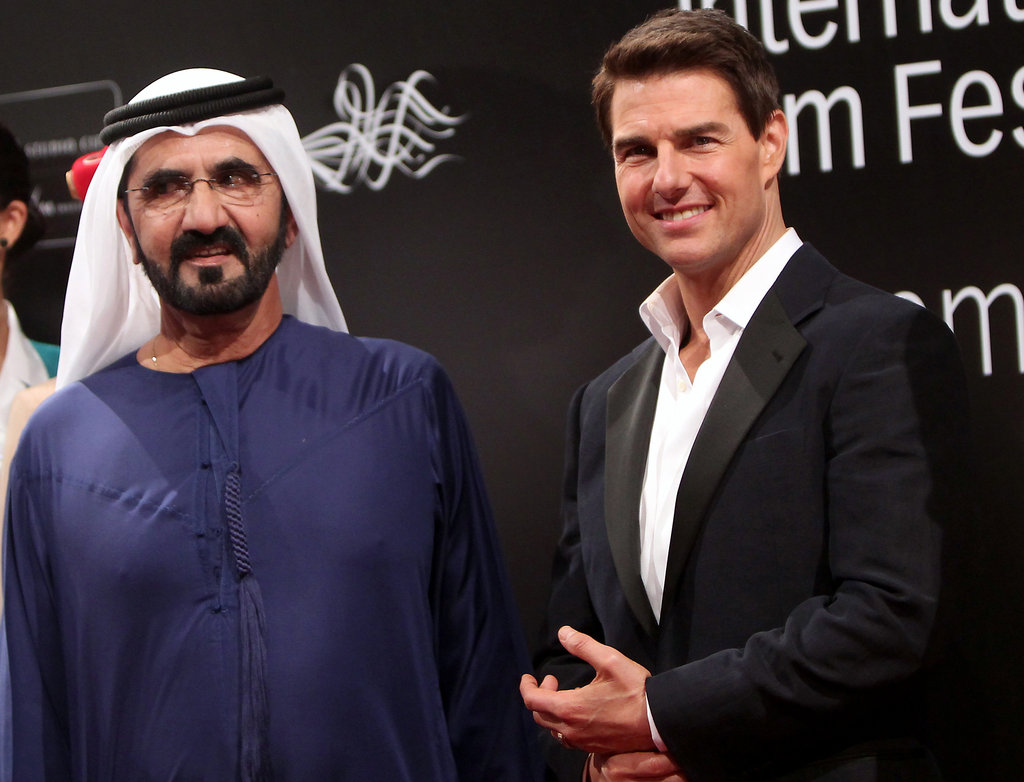 Tom Cruise posed with a fan.