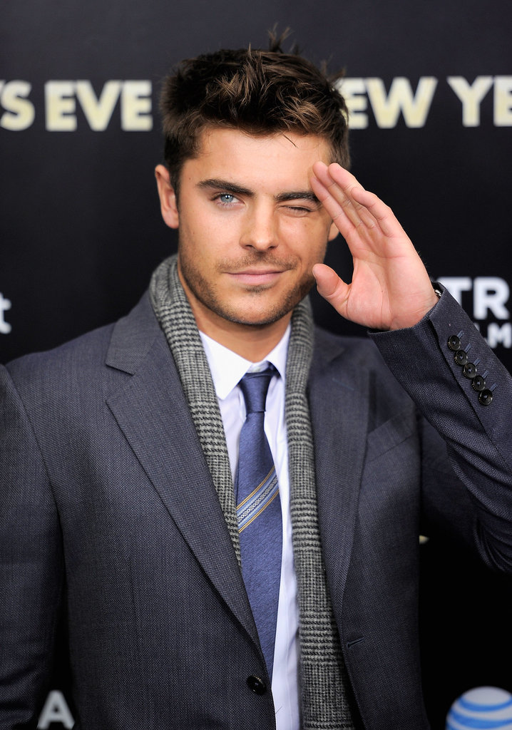 Zac Efron waved to fans outside the theater.