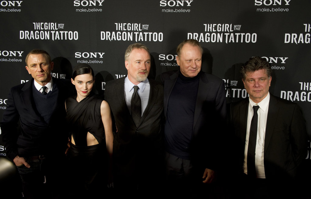 Daniel Craig, Rooney Mara, David Fincher, and Stellan Skarsgard posed with the film's screen writer, Steven Zaillian.