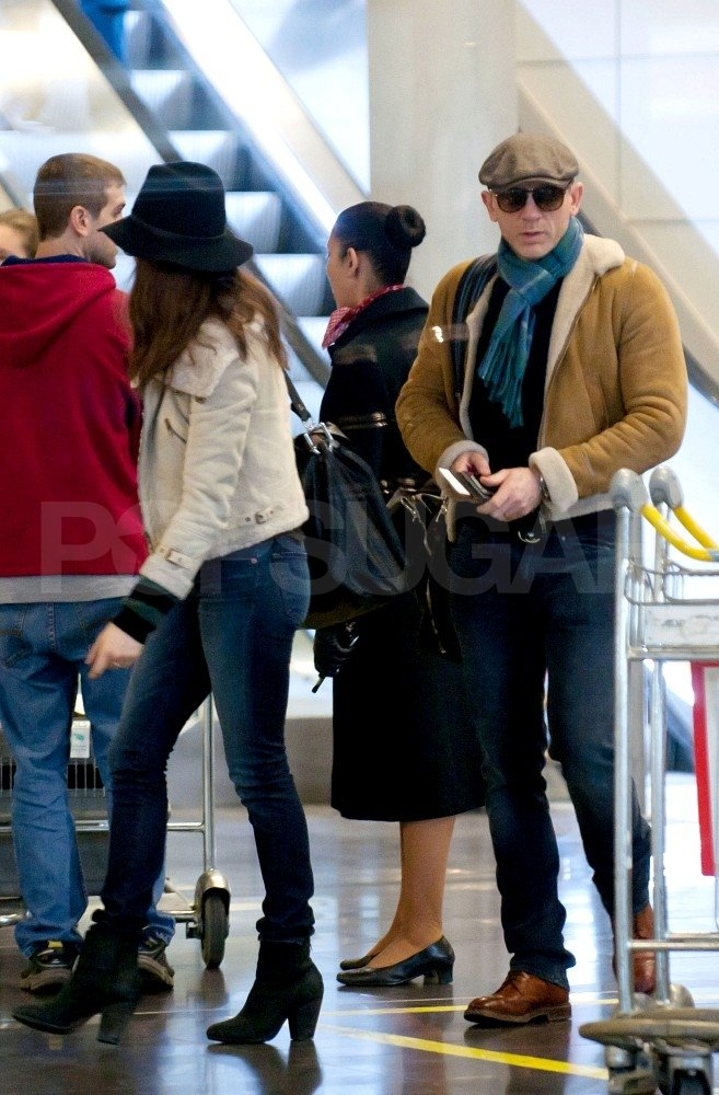 Rachel Weisz and Daniel Craig wore hats at the Paris airport.