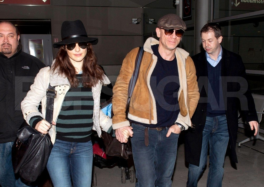 Rachel Weisz and Daniel Craig smiled as their photos were taken.