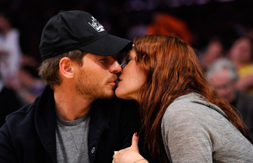Drew and Will shared a sweet kiss during a break from game play during an April 2011 LA Lakers game.