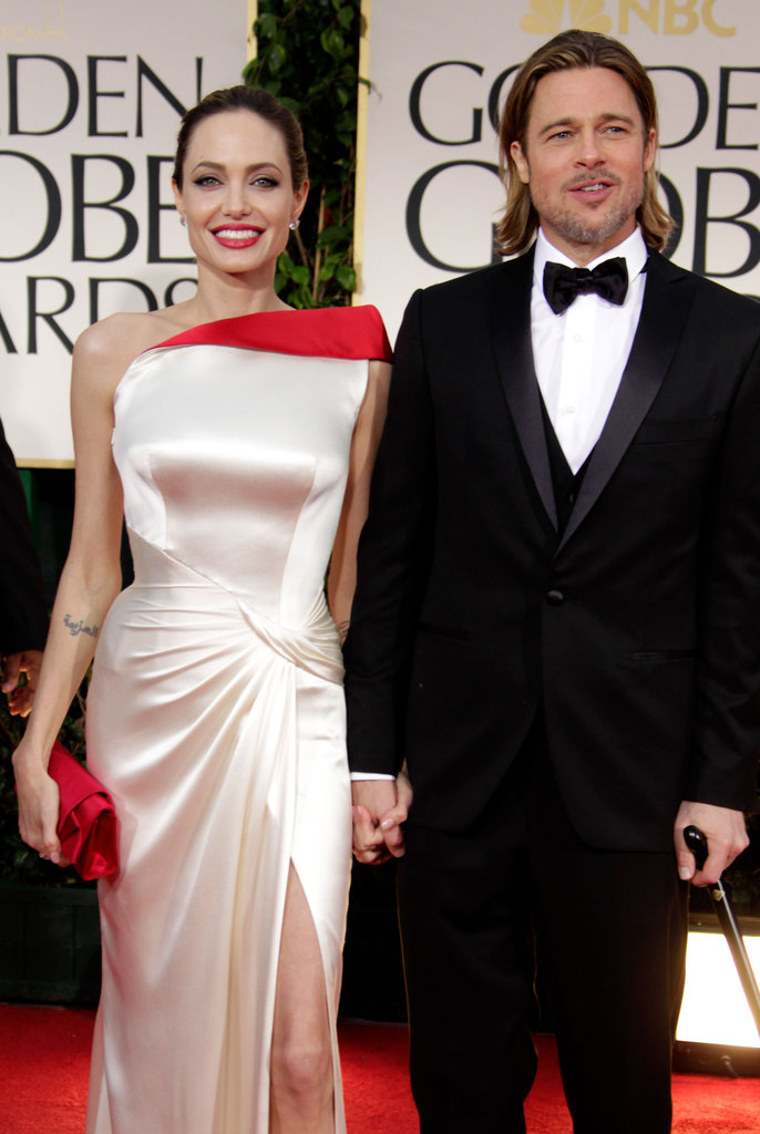 Angelina Jolie and Brad Pitt smiled together on the red carpet.