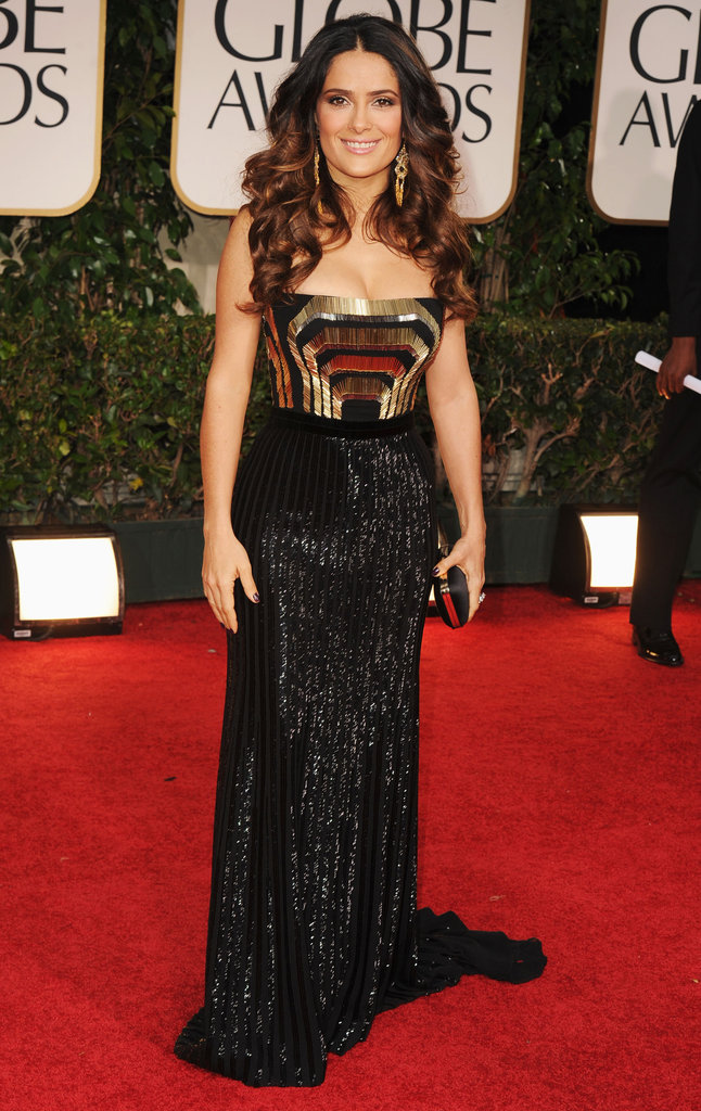 Salma Hayek channeled an ultra-sexy glow on the red carpet in her art-deco-inspired black and gold strapless Gucci Premiere gown. The black sequined skirt was a standout feature of the overall glitzy look.