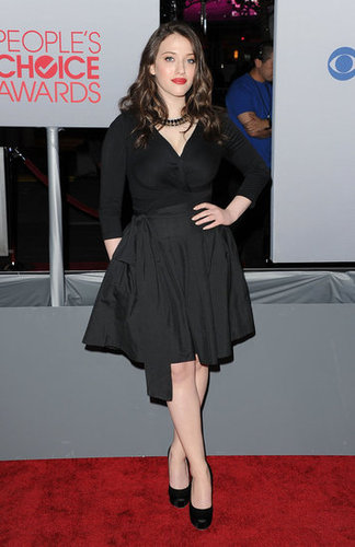Kat Dennings in a black dress.