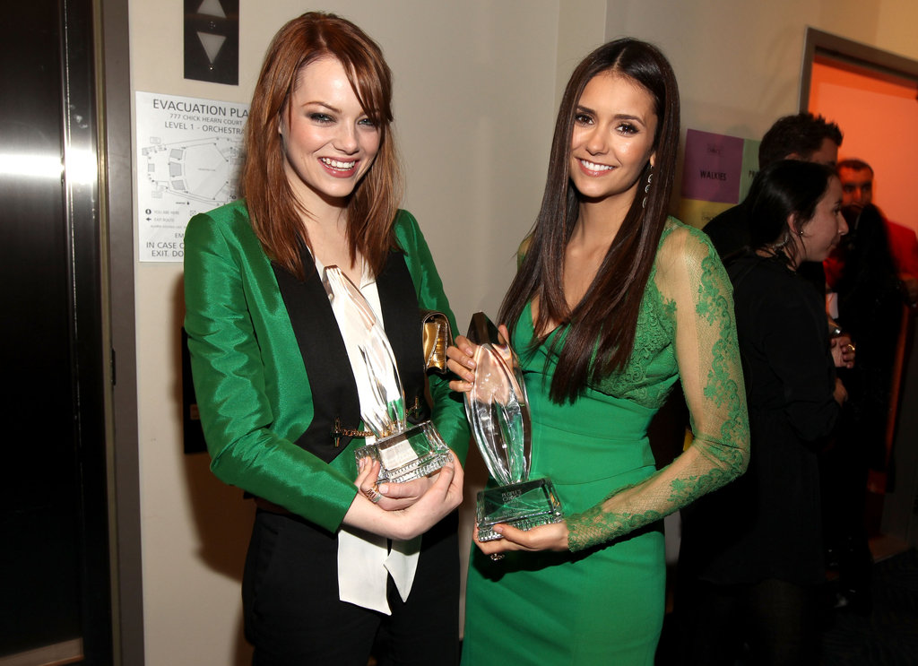 Emma Stone and Nina Dobrev compared green ensembles.