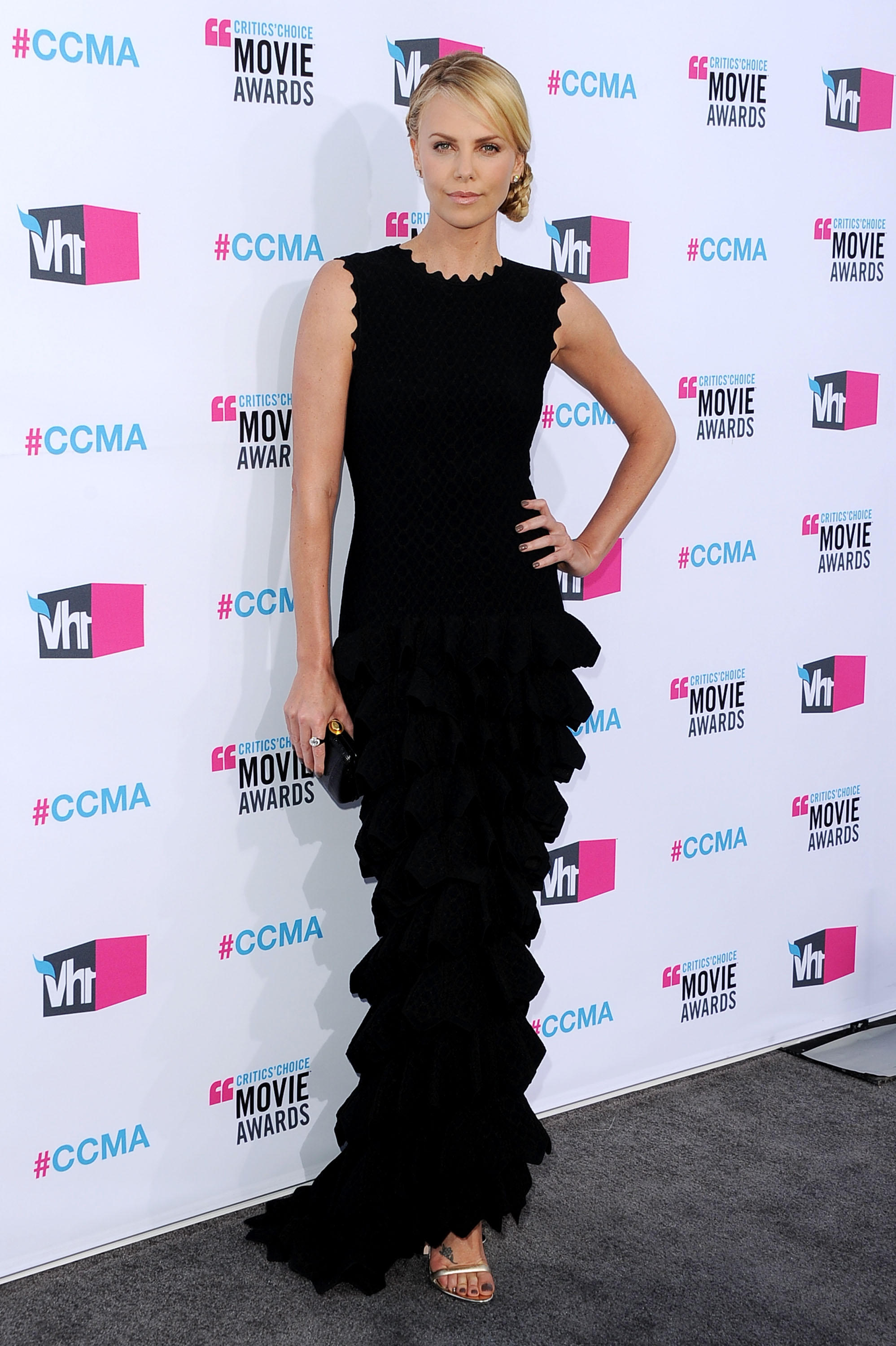 Charlize Theron in a layered black dress at the 2012 Critics' Choice Movie Awards.