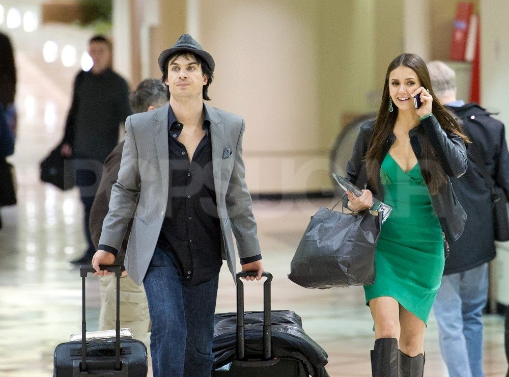 Nina Dobrev shared her good news on the phone at LAX with Ian Somerhalder.