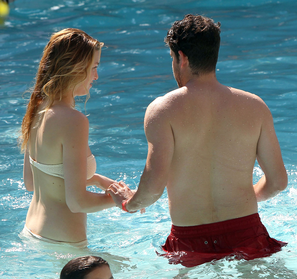 Whitney Port held hands with a mystery man in a pool.