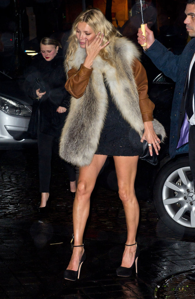 Kate Moss stepped out of her car on a rainy night in Paris.