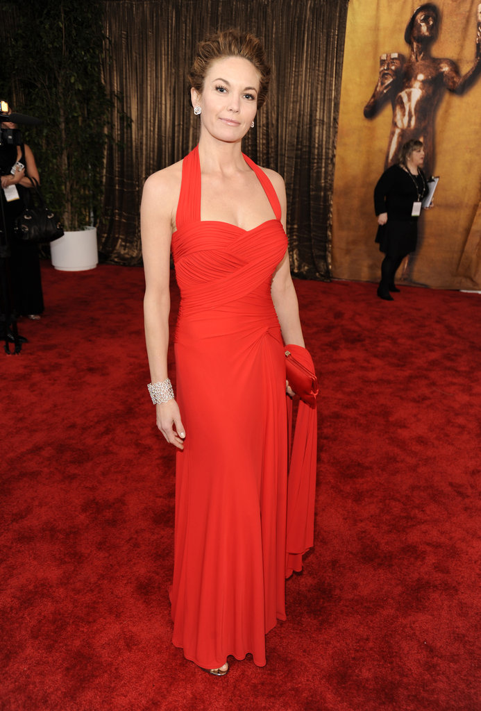 Diane Lane once again defies all logic and aging in this gorgeous red halter dress by David Meister in '09.