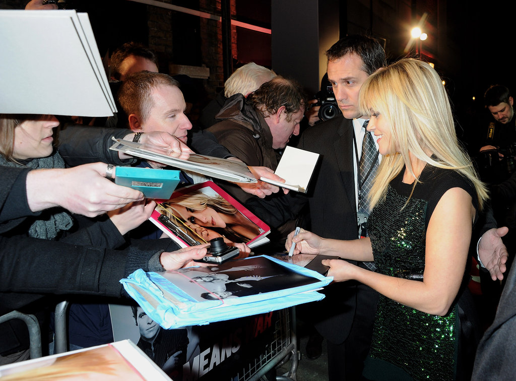 Reese signed autographs for fans.