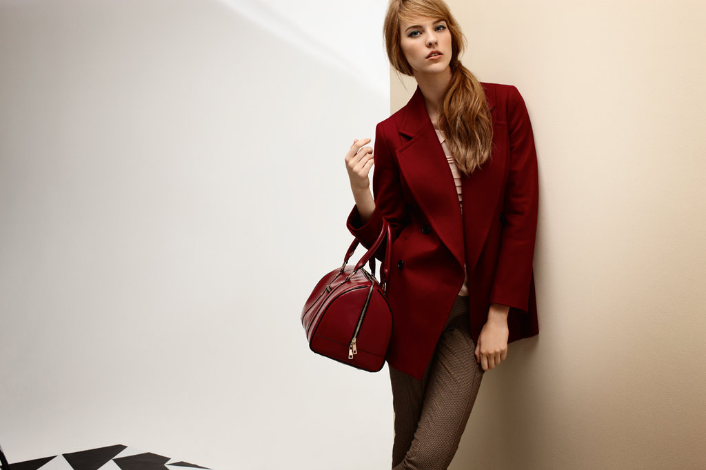 Crombie Coat $379, Pleat Blouse $159, Houndstooth Pants $149 and Travel Bag $199.