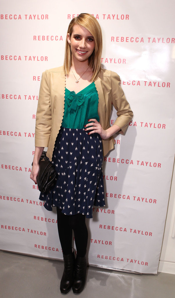 At Rebecca Taylor's LA store opening in December 2011, Emma fed her sweet-girl side with a heart skirt, emerald bow top, and tan leather jacket. Mimic this adorable outfit with similarly girlie pieces.       Mid-length Skirts by Kate SpadeBoots by Report