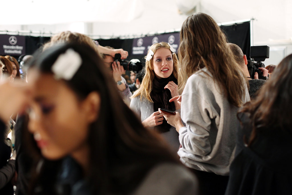 Models catch up backstage. Photo: Roger Kisby