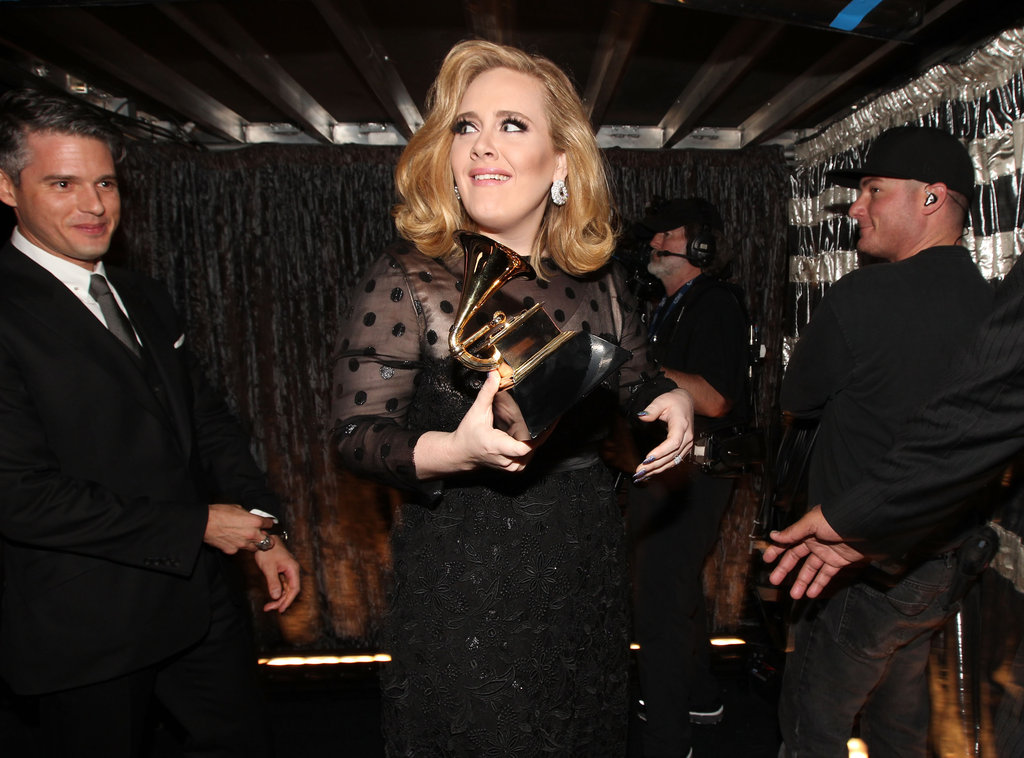 Adele and her adorable producer Paul Epworth celebrated a win backstage.