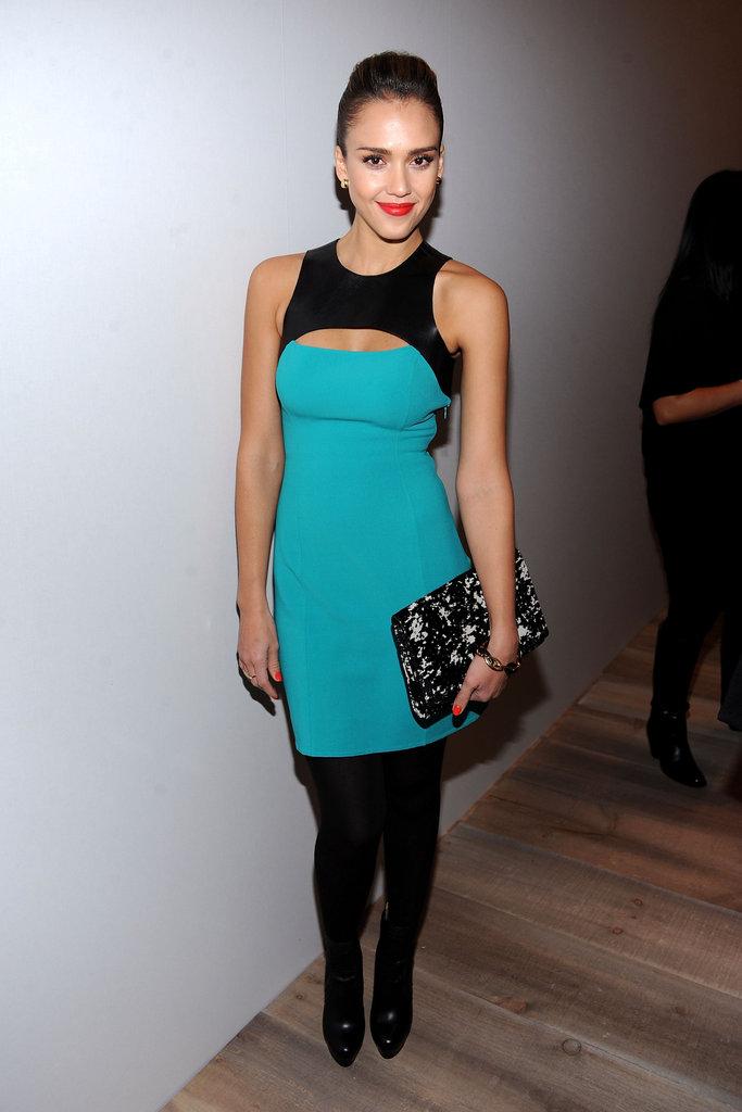 Jessica Alba posed backstage at Michael Kors.