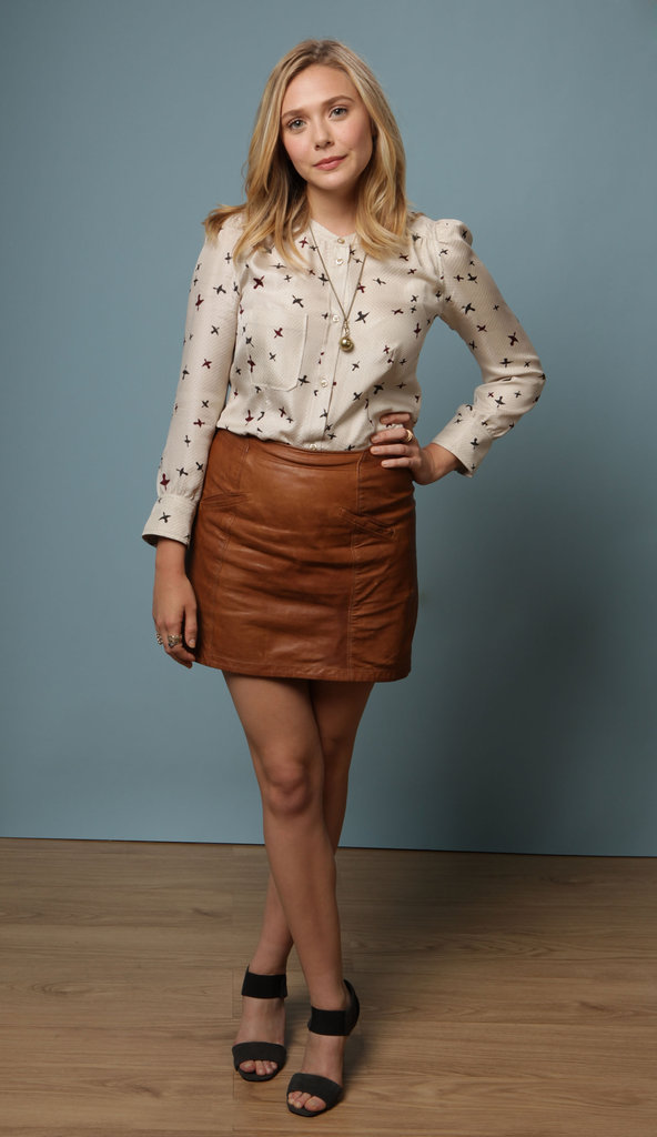 In September 2011 at the Toronto Film Festival, Elizabeth donned a playful bird blouse tucked into a super-chic brown leather miniskirt.      Longsleeve Tops by AsosSandals by Nine West