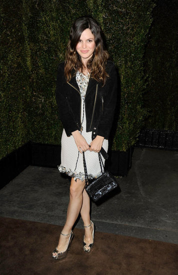 Rachel Bilson did her classic mixup, pairing a dainty dress with a black jacket.