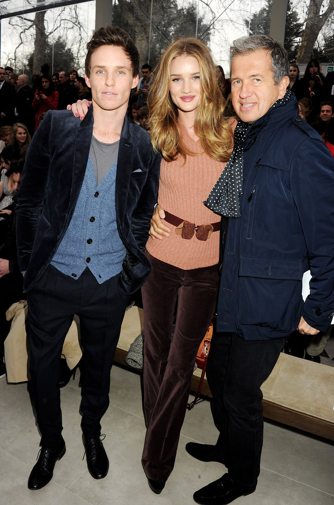 Rosie Huntington-Whiteley posed with Eddie Redmayne and Mario Testino at Burberry.