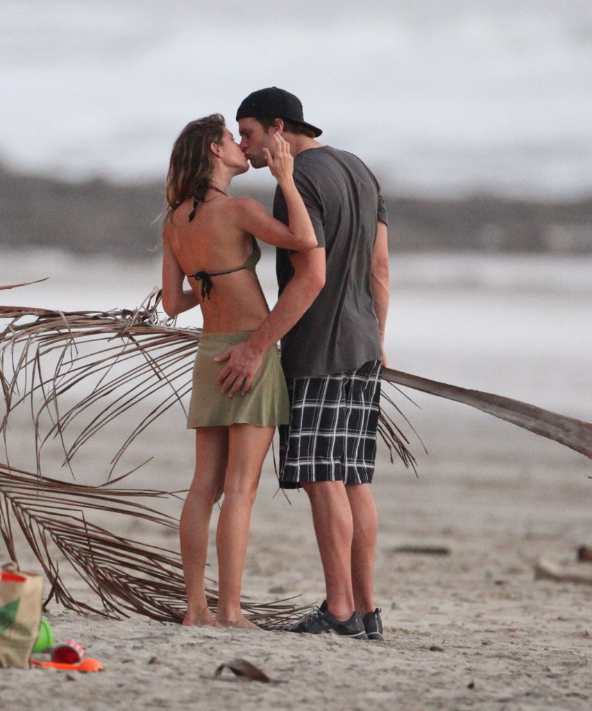 Gisele Bundchen and Tom Brady kissed and hugged.