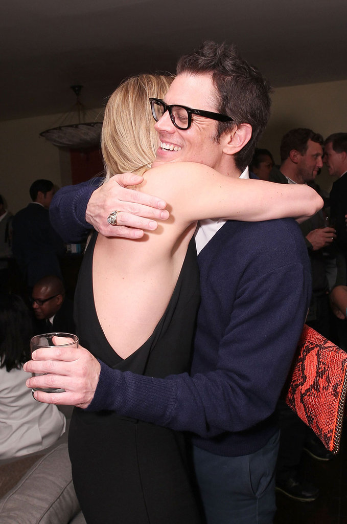 Charlize Theron hugged Johnny Knoxville.