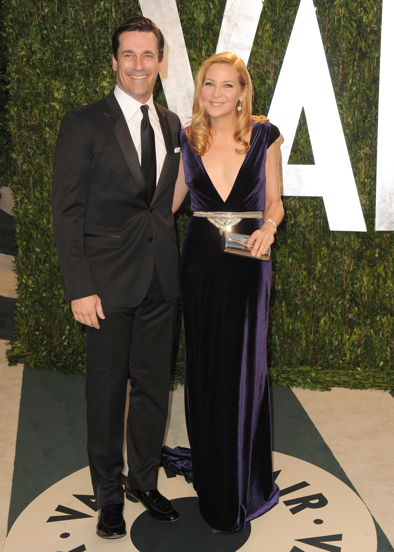 John Hamm and Jennifer Westfeldt arrive at the Vanity Fair party.