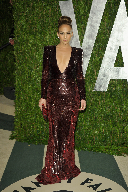 Jennifer Lopez in a dark crimson Zuhair Murad sequined gown.
