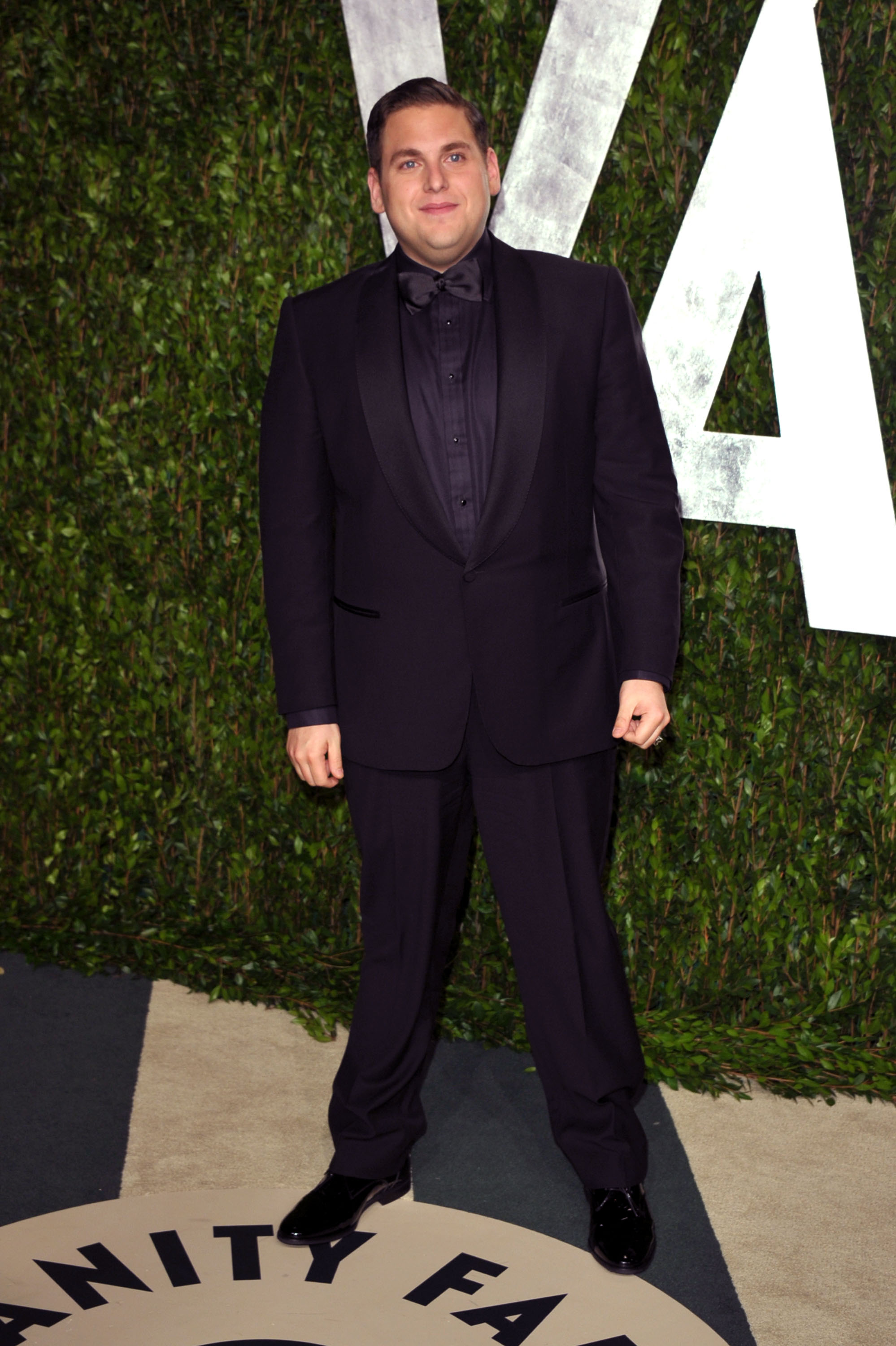 Jonah Hill enters the Vanity Fair party.