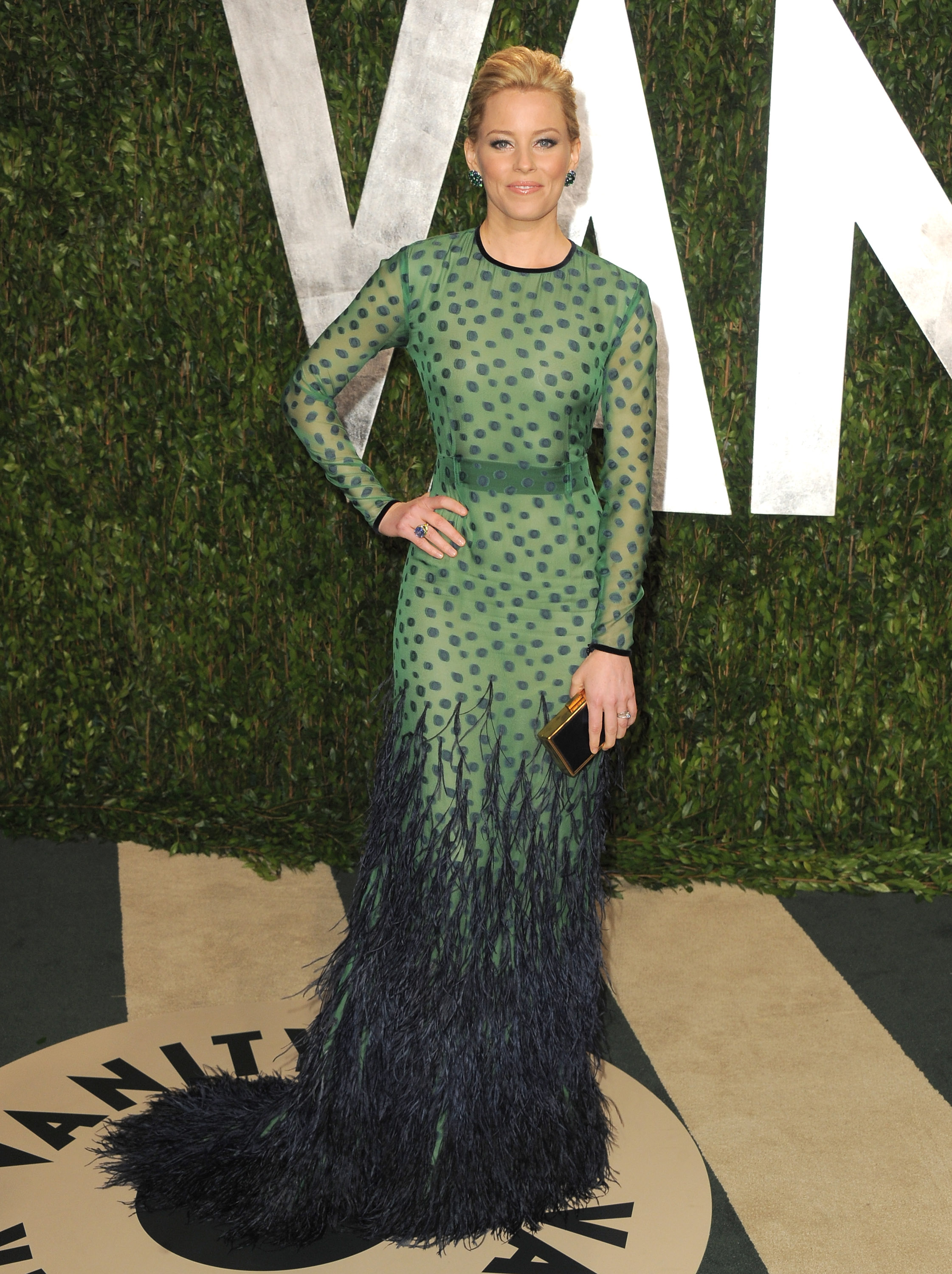 Banks in an elegant peacock-inspired Chadwick Bell frock.