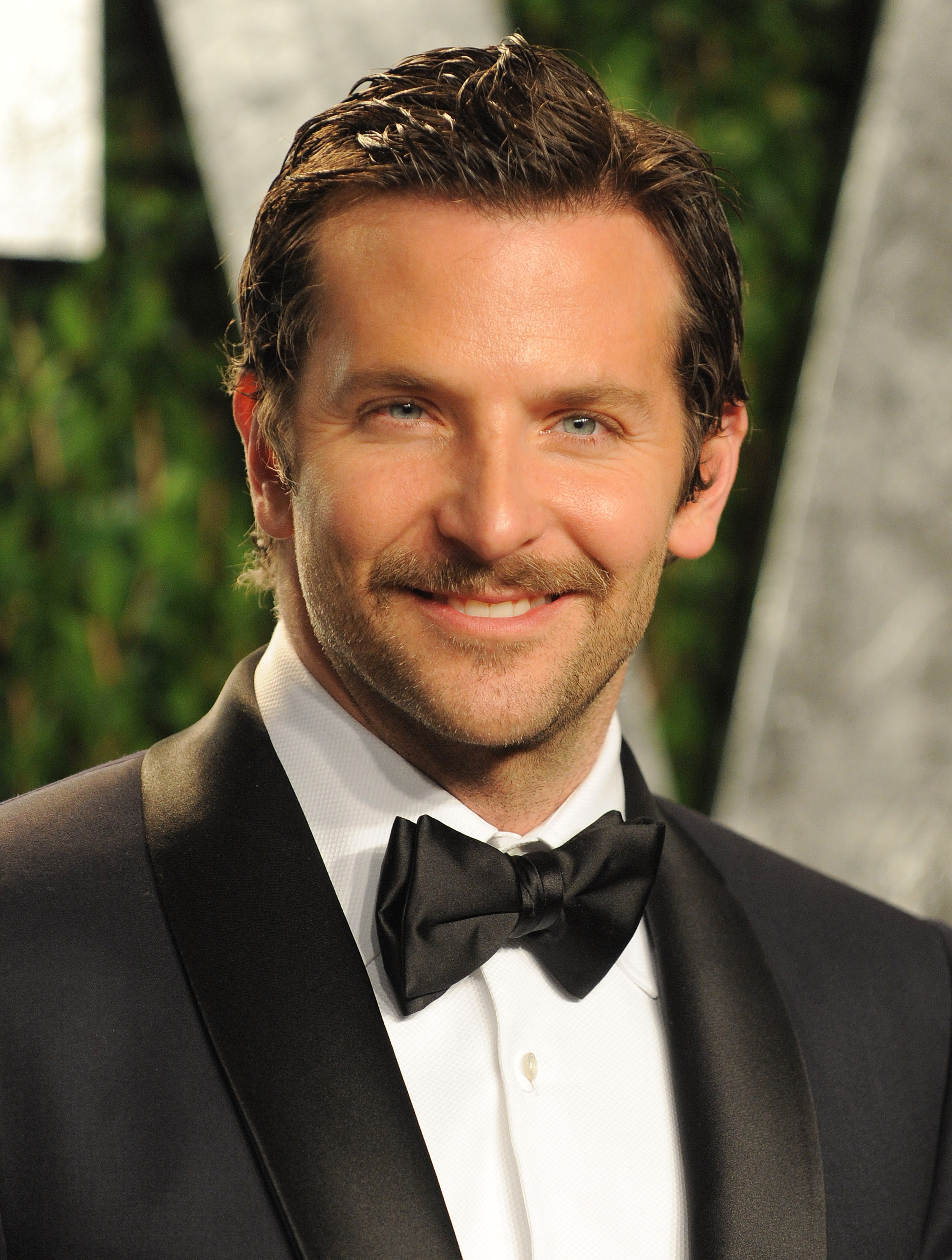Bradley Cooper brings his mustache to the Vanity Fair party.
