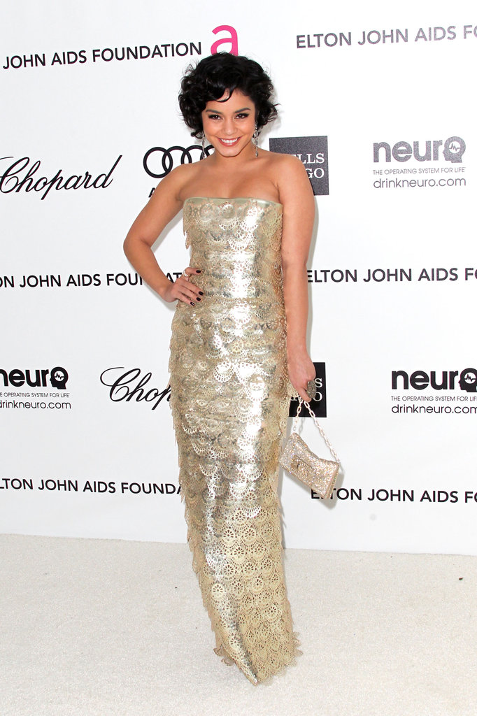 Vanessa Hudgens glammed up in a gold Georges Chakra gown.