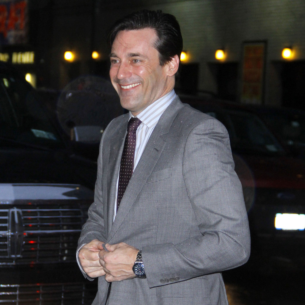Jon Hamm in a gray suit.