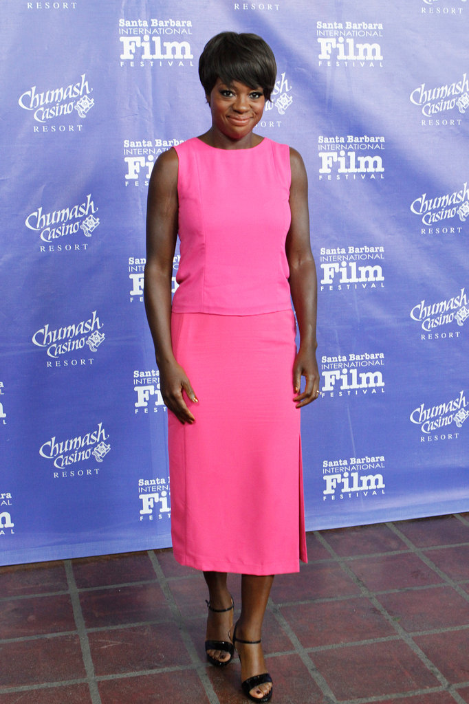 Viola Davis wearing a sleeveless top and skirt from H&M's Exclusive Glamour Conscious Collection