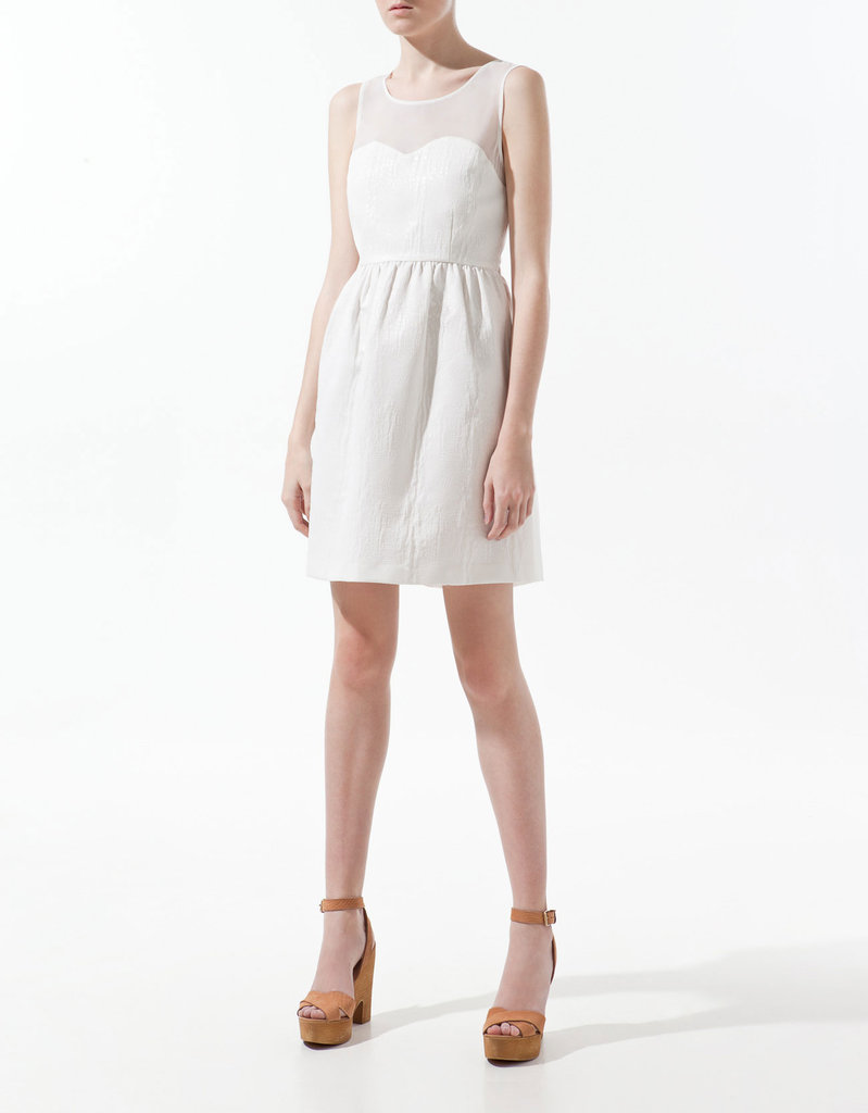 With a subtle snake print and sheer inset, this LWD has a perfectly girlie angle with just a hint of sexy.  Zara Snake Print Dress ($80)