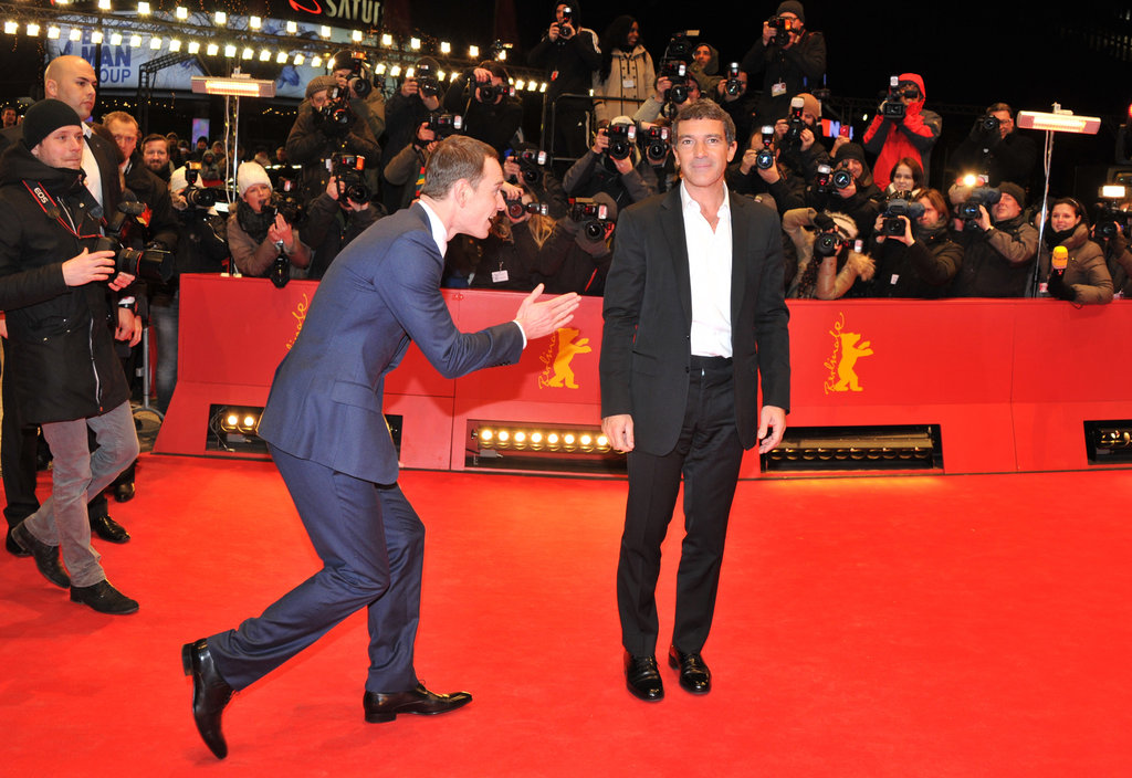 Michael Fassbender was in crack-up mode with Haywire costar Antonio Banderas at a February 2012 premiere in Berlin.