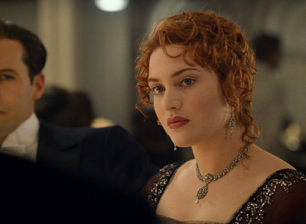 When dressing for dinner was really dressing up for dinner — Rose dons gorgeous period-piece jewels and a scoop-neck gown to show them off.