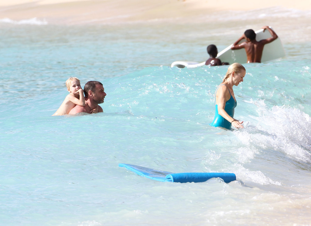 Naomi Watts got out of the ocean followed by Liev Schreiber and their son.