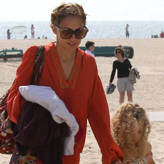 Nicole Richie Wears Orange Winter Kate Top in Malibu