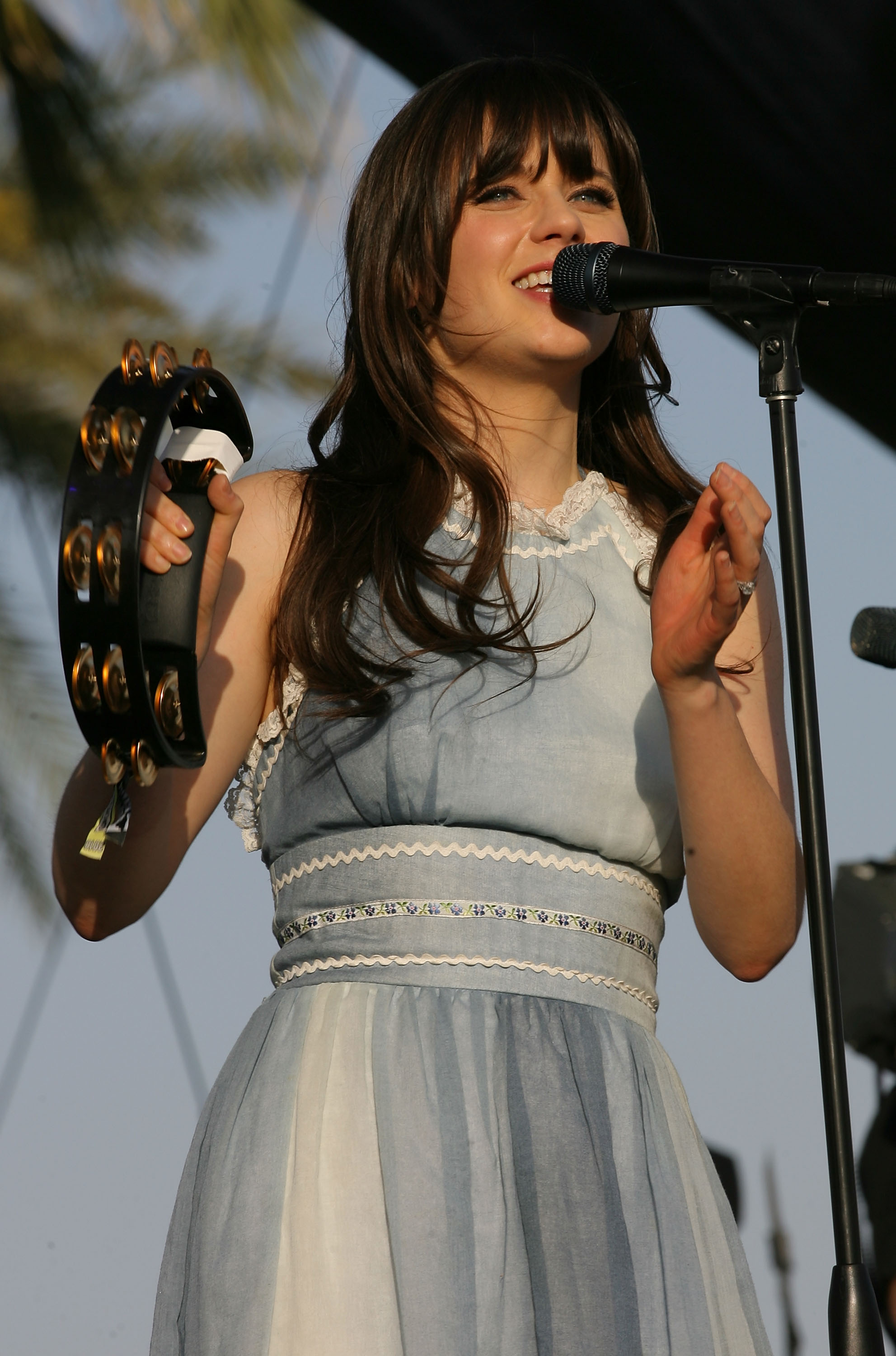 Zooey Deschanel sang with music partner M. Ward as part of She and Him in 2011.