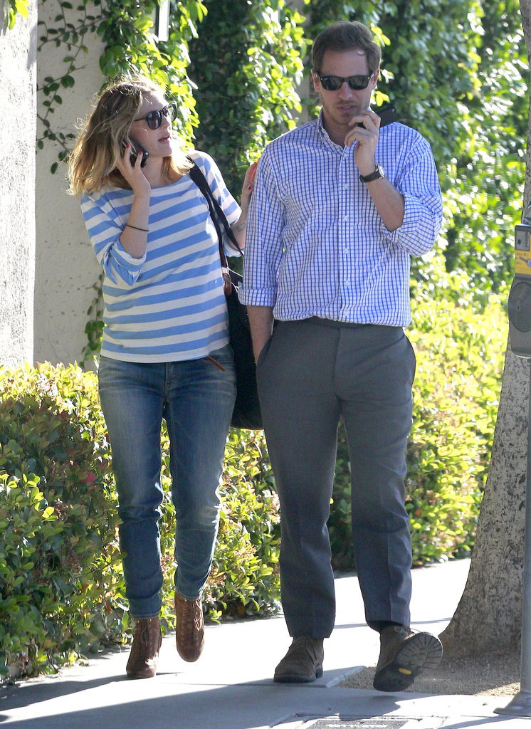Drew Barrymore and her fiancé Will Kopelman stuck together for a walk around their LA neighborhood.