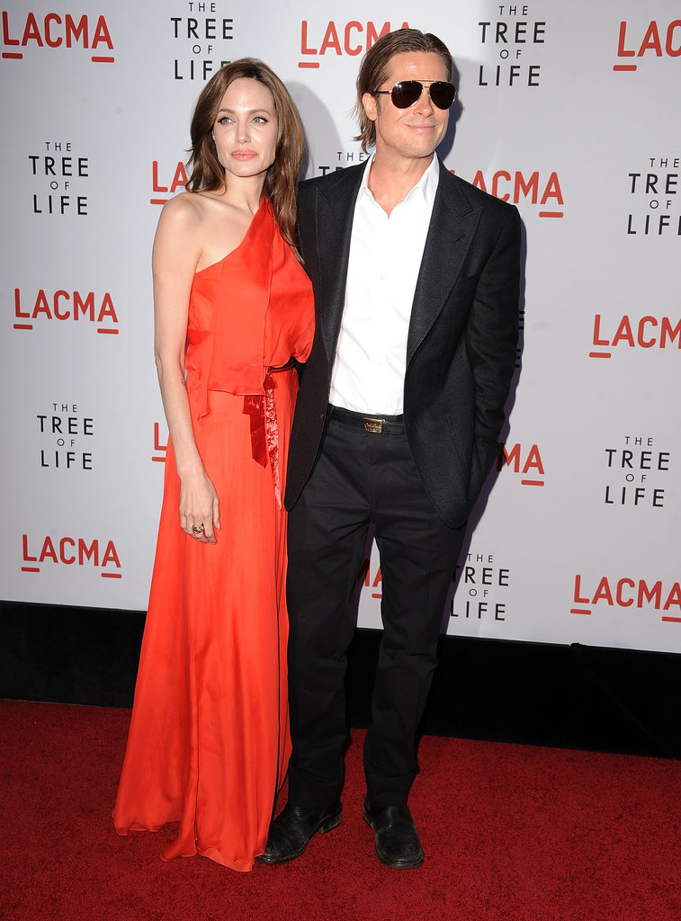 Angelina Jolie stuck by Brad Pitt's side at his LA May 2011 Tree of Life premiere.