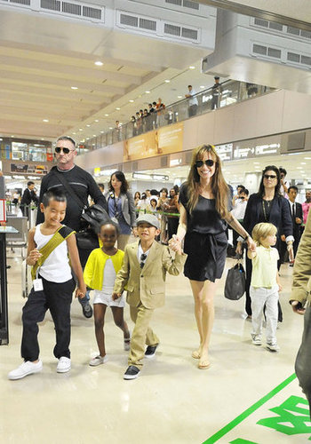 Angelina Jolie and the kids walked hand in hand at the Narita International Airport in Japan in July 2010.