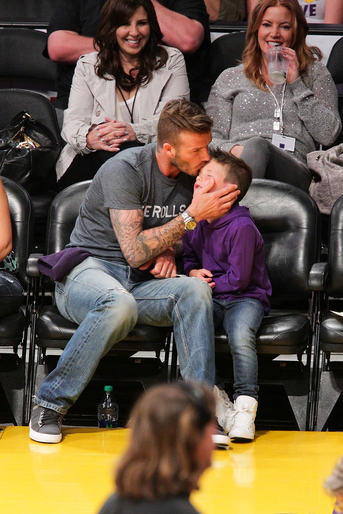 David Beckham showed his love for son Cruz Beckham by planting a kiss on his forehead at the Lakers game in LA.