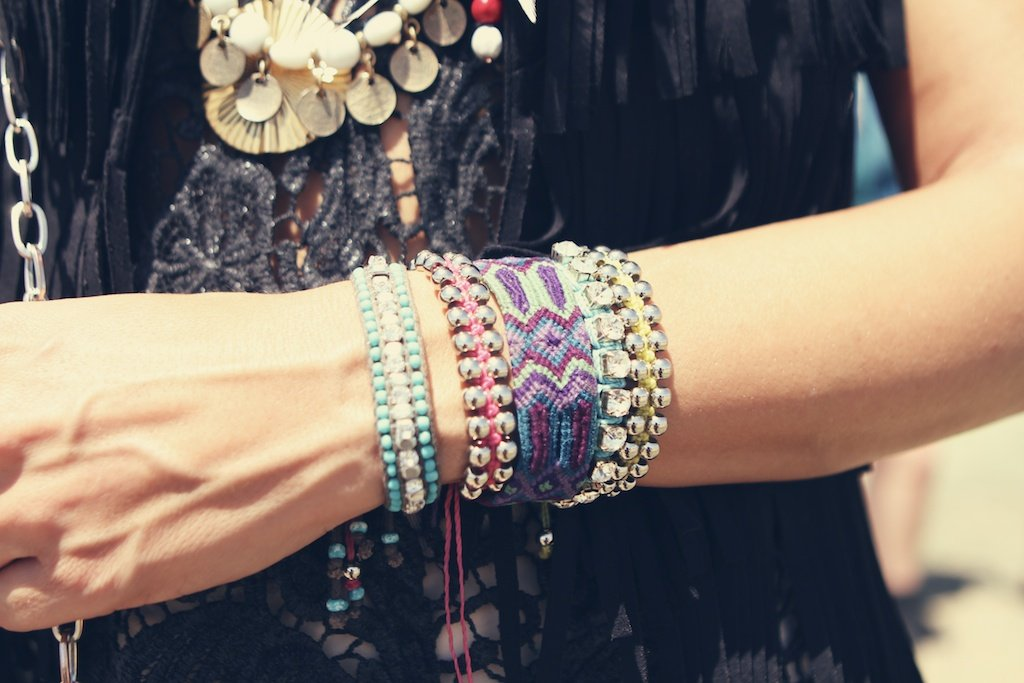 A colourful wrist arrangement — we're especially taken with the purple woven creation.