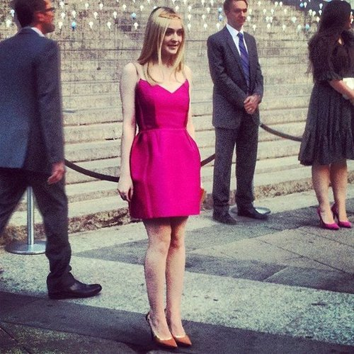 Ever the charming style-setter, Dakota Fanning chose a hot-pink Lanvin number to go with her nude pointy-toe pumps and gold halo. It was even more gorgeous in person.