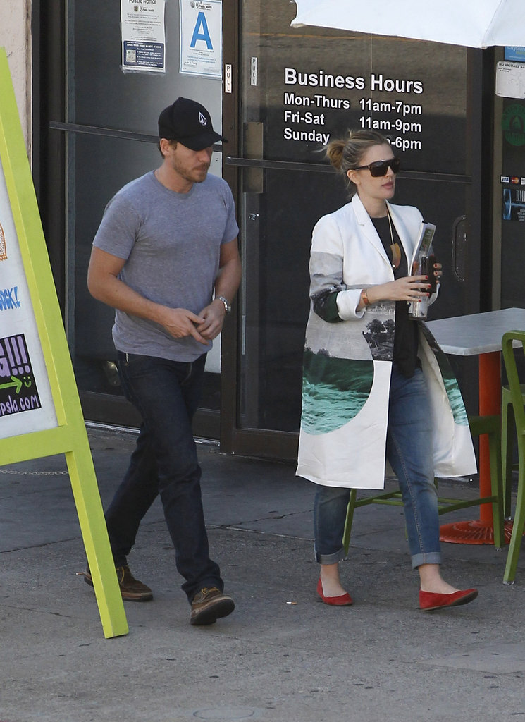 Drew Barrymore Keeps Baby-Bump Watchers Guessing Out With Her Man